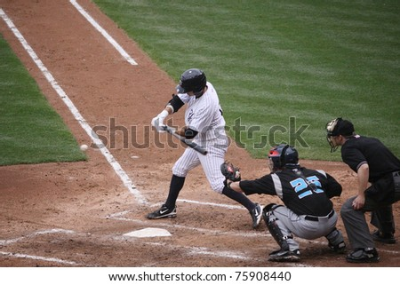 SCRANTON, PA -April 24: Scranton Wilkes-Barre Yankees batter #19 Ramiro Pena takes a swing at a pitch against the Syracuse Skychiefs at PNC Field  on April 24, 2011 in Scranton, Pa - stock photo