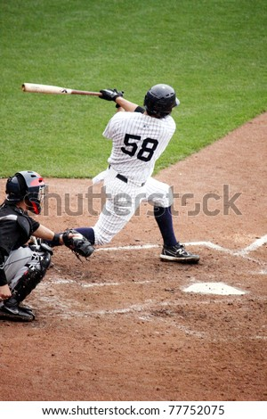SCRANTON, PA - APRIL 24: Scranton Wilkes Barre Yankees Jose Gil takes a big swing at a pitch during a game against the Syracuse Skychiefs at PNC Field on April 24, 2011 in Scranton, PA - stock photo