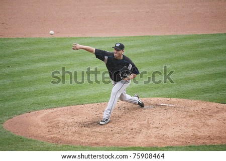 SCRANTON, PA -April 24: Syracuse Skychiefs' pitcher Yunesky Maya fires a pitch during a game against the Scranton Wilkes Barre Yankees at PNC Field  on April 24, 2011 in Scranton, Pa - stock photo