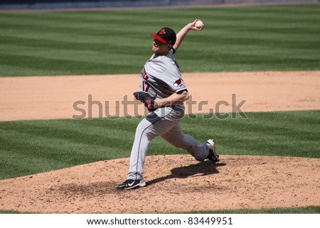 SCRANTON, PA - AUGUST 24: Rochester Red Wings pitcher Eric Hacker fires a pitch during a game against the Scranton Wilkes Barre Yankees at PNC Field on August 24, 2011 in Scranton, PA. - stock photo