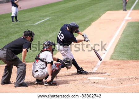 SCRANTON, PA - AUGUST 24: Scranton Wilkes Barre Yankees batter Doug Bernier swings at  a pitch during a game against the Rochester Red Wings at PNC Field on August 24, 2011 in Scranton, PA. - stock photo