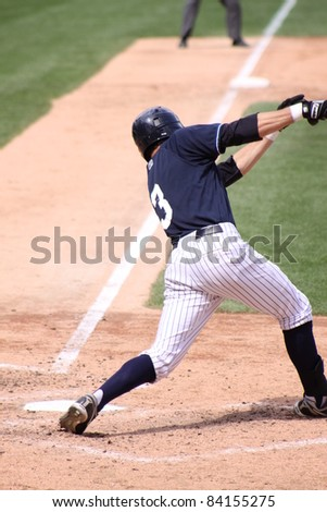 SCRANTON, PA - AUGUST 24: Scranton Wilkes Barre Yankees batter Ray Kruml watches his hit during a game against the Rochester Red Wings at PNC Field on August 24, 2011 in Scranton, PA. - stock photo