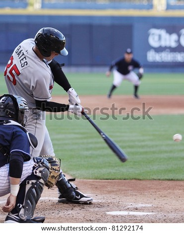 SCRANTON, PA - JULY 9: Rochester Red Wings batter Aaron Bates swings at a pitch during a game against the Scranton Wilkes Barre Yankees at PNC Field on July 9, 2011 in Scranton, PA. - stock photo
