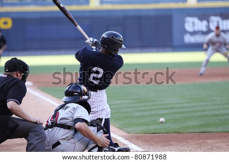 SCRANTON, PA - JULY 9: Scranton Wilkes Barre Yankees batter Greg Golson swings and hits the ball in a game against the Rochester Red Wings at PNC Field on July 9, 2011 in Scranton, PA. - stock photo