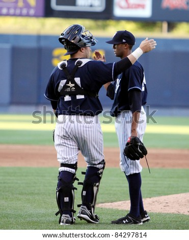 SCRANTON, PA - JULY 9: Scranton Wilkes Barre Yankees pitcher D.J. Mitchell celebrates a win with catcher P.J. Pillitere against the Rochester Red Wings at PNC Field on July 9, 2011 in Scranton, PA. - stock photo