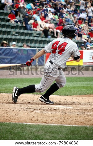 SCRANTON, PA - MAY 24:Indianapolis Indians catcher Wyatt Toregas watches his hitagainst the Scranton Wilkes Barre Yankees at PNC Field on May 24, 2011 in Scranton, PA. - stock photo