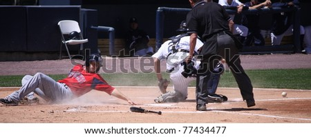 SCRANTON, PA - MAY 8: Pawtucket Red Sox Shortstop Drew Sutton is safe at home during a game against the Scranton Wilkes Barre Yankees at PNC Field on May 8, 2011 in Scranton, PA. - stock photo