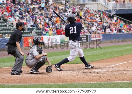 SCRANTON, PA - MAY 24: Scranton Wilkes Barre Yankees batter Jesus Montero swings at a pitch in a game against the Indianapolis Indians at PNC Field on May 24, 2011 in Scranton, PA. - stock photo