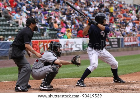 SCRANTON, PA - MAY 24: Scranton Wilkes Barre Yankees batter Jesus Montero swings in the batter's box during a game against the Indianapolis Indians at PNC Field on May 24, 2011 in Scranton, PA. - stock photo