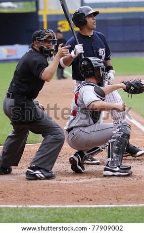 SCRANTON, PA - MAY 24: Scranton Wilkes Barre Yankees batter reacts to a called strike  during a game against the Indianapolis Indians at PNC Field on May 24, 2011 in Scranton, PA. - stock photo