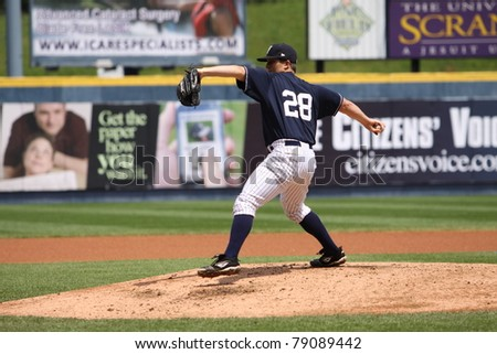 SCRANTON, PA - MAY 24: Scranton Wilkes Barre Yankees pitcher Adam Warren pitching during a game against the Indianapolis Indians at PNC Field on May 24, 2011 in Scranton, PA. - stock photo