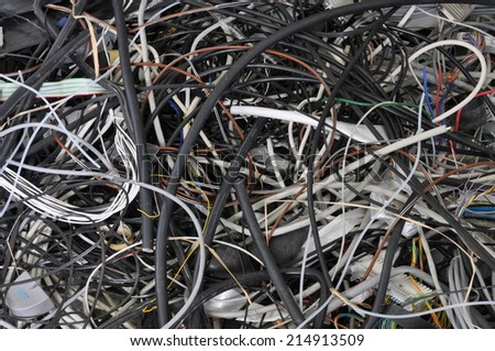 Scrap cable in a waste landfill - stock photo