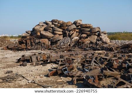 scrap metal heap outdoors - stock photo