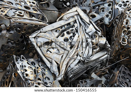 Scrap metal in compressed blocks for recycling. - stock photo