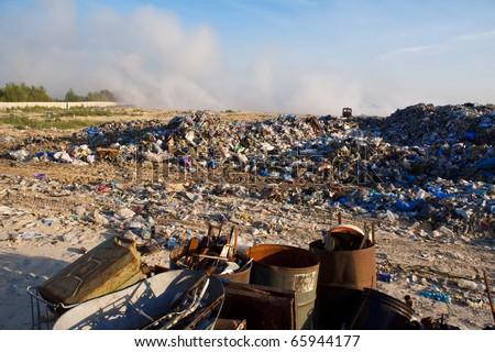 Scrap metal, plastic and blue sky. - stock photo