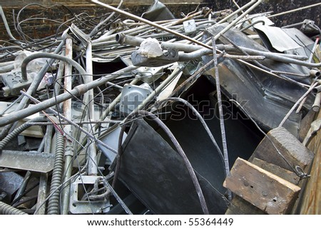 Scrap metal rusting away in a junk yard - stock photo