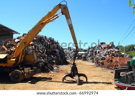 scrap metal scrap-iron junk outdoor with crane - stock photo