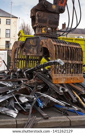 Scrap metal waste of iron and aluminum for recycling at a demolishion site - stock photo