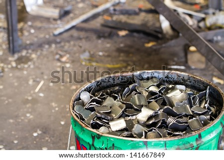 Scrap steels in the bucket - stock photo
