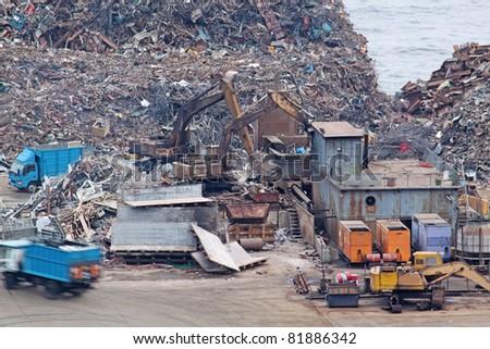 scrap yard recycling at day in hong kong - stock photo