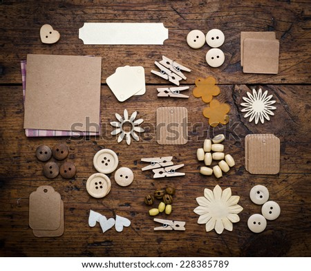 scrapbook elements on wood background  - stock photo