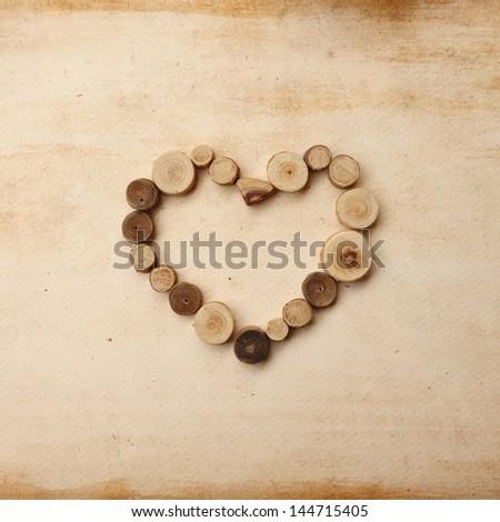Scrapbook love heart made of tree stumps - stock photo