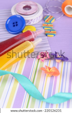 Scrapbooking craft materials on bright background