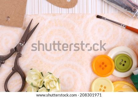 Scrapbooking craft materials on light background - stock photo