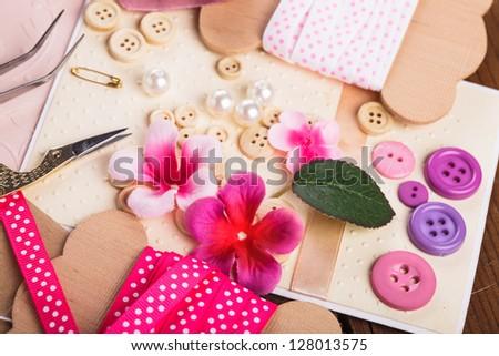 Scrapbooking craft materials, scrap paper, tools and decor - stock photo