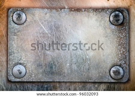 scraped  metal plate on rivets (screws);  abstract grunge  background - stock photo