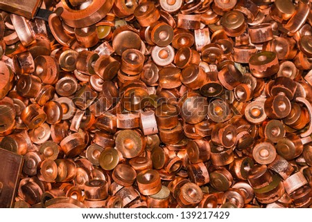 Scrapheap of copper from hole punching process, waiting for recycling - stock photo