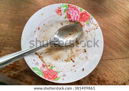 Scraps of food left on the plate - stock photo