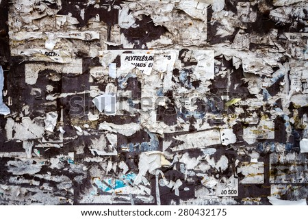 Scraps of paper on old bulletin board - stock photo