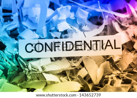 scraps of paper with the word confidential, symbolic photo for data destruction, bank secrecy and confidentiality - stock photo
