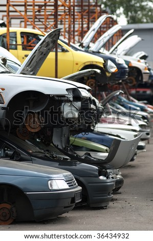 Scrapyard with used, broken cars - stock photo