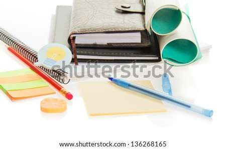Scratch paper, the handle, pencil and the elastic band, isolated on white