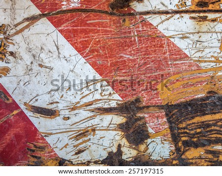 Scratched And Rusted Red And White Traffic Warning Sign - stock photo