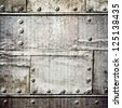 scratched  garage wall with riveted metal sheets ; - stock photo