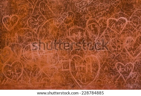 Scratched hearts on the grunge wall - stock photo