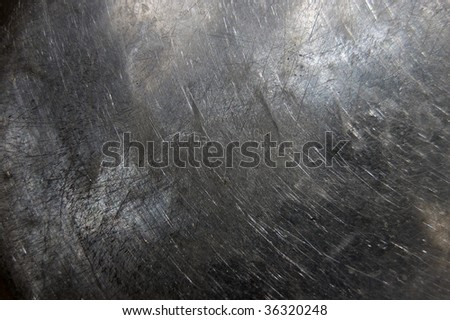 scratched metal surface / abstract industrial background /