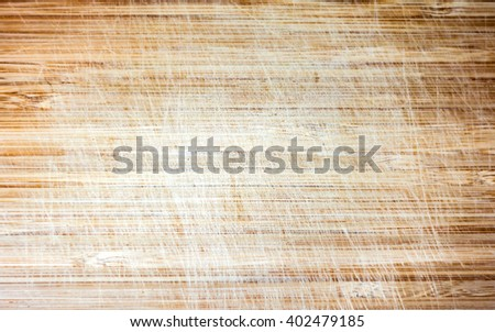Scratched old butcher's board as the background - stock photo