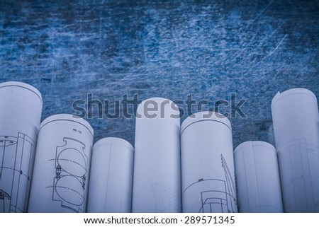 Scratched shiny metallic background with composition of blueprints construction concept. - stock photo