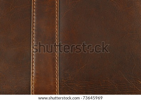 scratched worn leather texture with seam - stock photo