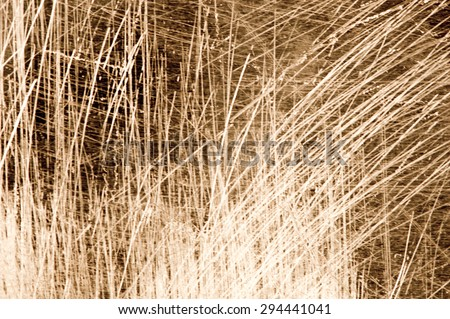 Scratches on a metallic gold background. - stock photo