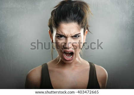 Scream of angry upset young woman