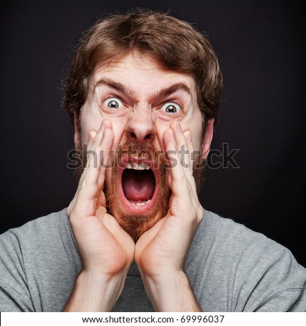 Scream of excited man making an announcement - stock photo