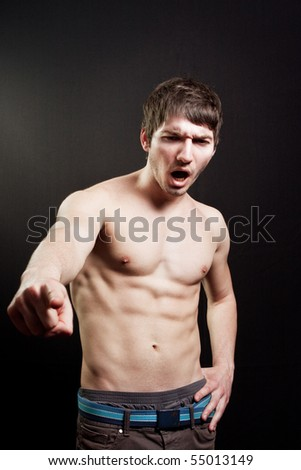 Scream of muscular sexy man over black background