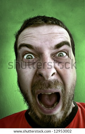 Scream of shocked scared man - stock photo
