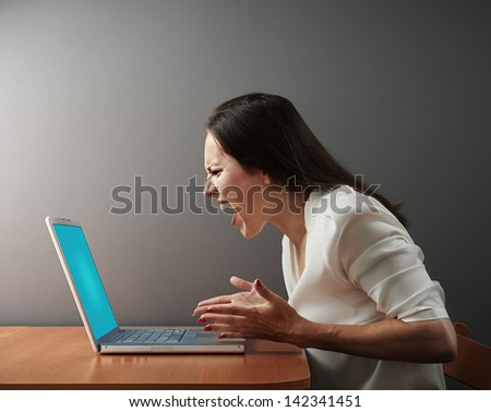 screaming angry woman with laptop
