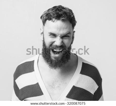 Screaming beard man portrait black and white - stock photo